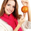 Beautiful smiling girl with Christmas ball isolated on white — Stock Photo