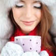 Beautiful girl in hat with cup close-up — Stock Photo