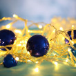 Christmas ornaments and garland close-up — Stock Photo #35575457