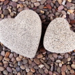 Two hearts on small sea stones, close up — Stock Photo