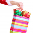 Hand holds package with New Year gifts isolated on white — Stock Photo