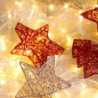 Christmas ornaments and garland on bright background close-up — Stock Photo #35575755