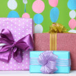 Beautiful presents on table on bright background — Stock Photo
