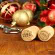 Wine corks with new Year toys on wooden table close-up — Stockfoto