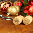 Wine corks with new Year toys on wooden table close-up — Stock Photo