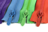 Multicolored zippers isolated on white — Stock Photo