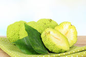 Osage Orange fruits (Maclura pomifera), on wooden table — Stock Photo