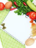 Gotowania. artykuły spożywcze z pustym książki kucharskiej z bliska — Zdjęcie stockowe
