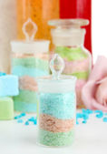 Aromatic salts in glass bottles and body scrubs, isolated on white — Stock Photo