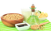Soy products on table on white background — Stock Photo