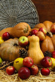 Autumn composition of fruits and pumpkins on straw on wooden background — Stock Photo