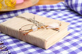 Composition with old book, eye glasses, and plaid on wooden background — Stok fotoğraf