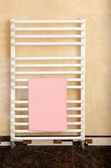 Color towel on radiator in bathroom — Stock Photo
