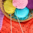 Colorful wool sweaters and balls of wool close-up — Stock Photo #35693535