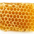 Sweet honeycomb isolated on white — Stock Photo #35693937