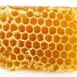 Sweet honeycomb isolated on white — Stock Photo