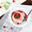 PannCottwith raspberry sauce, on wooden background — Stock Photo #35694575