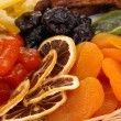 Dried fruits on wicker plate close-up — Stock Photo