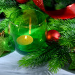 Composition with Christmas balls, candle and decorations on fir tree, close up — Stock Photo #35696377
