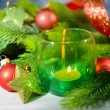 Composition with Christmas balls, candle and decorations on fir tree, close up — Stock Photo