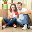 Young couple celebrating moving to new home — Stock Photo #35696985