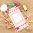 Stock Photo: Beautiful hand made post card and scrapbooking elements, on wooden table