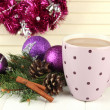 Cup of hot cacao with bumps and Christmas decorations on table on wooden background — Foto Stock #35698289
