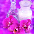 Beautiful spa setting with orchid on purple background — Stock Photo