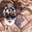 Mask on golden fabric background — Foto Stock