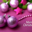 Christmas balls on fir tree, on color background — Stock Photo #35698545
