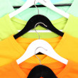 T-shirts on hangers close-up — Stock Photo