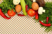 Conceito de cozinha. legumes em fundo de toalha de mesa — Fotografia Stock
