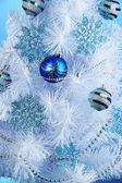 White Christmas tree on blue background — Stockfoto
