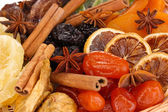Dried fruits with cinnamon and anise stars close-up — Stock Photo