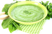 Tasty spinach soup, on white table — Stock Photo