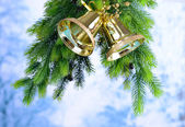 Bells with Christmas decoration on light background — Stock Photo