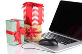 Laptop, gifts and computer mouse isolated on white — Zdjęcie stockowe