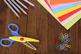 Colorful cardboard and scissors on table close-up — Stock Photo