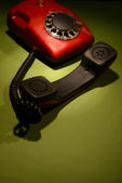 Red retro telephone on dark color background — Stock Photo