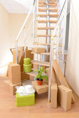 Stack of cartons near stairs: moving house concept — Stock Photo