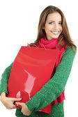 Beautiful smiling girl with gift bag isolated on white — Stock Photo