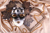 Mask on golden fabric background — Stock Photo