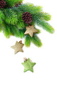 Christmas decorative stars on fir tree, isolated on white — Zdjęcie stockowe