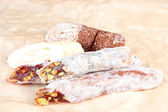 Tasty oriental sweets (Turkish delight), on brown background — Stock Photo