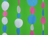 Decorative felt garland on green background — Stock Photo