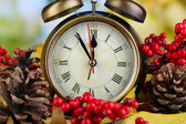 Old clock on autumn leaves on natural background — Stock Photo