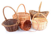 Empty wicker baskets, isolated on white — Stock Photo