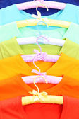 T-shirts on hangers close-up — Stockfoto