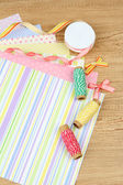 Paper for scrapbooking and tools, on wooden table — Стоковое фото