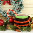 Cup of hot cacao with Christmas decorations on table on wooden background — Stock Photo #35820127
